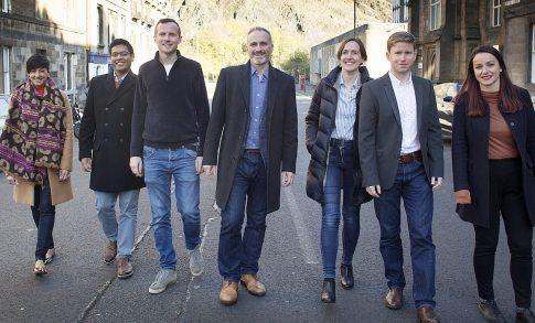 WhisperClaims team walking in front of Edinburgh Castle
