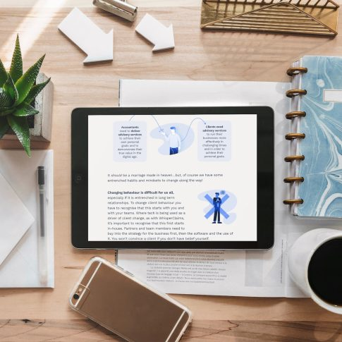 """A bright, modern desk of someone at work, with an open tablet device showing WhisperClaims' """"Compliance to Advisory"""" ebook"""